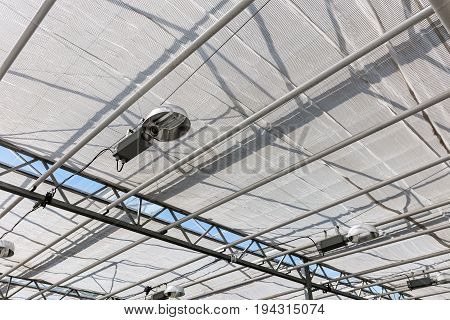 Modern Glass Roof Inside Greenhouse With Lamps For Lighting Plants