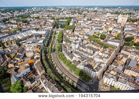 Aerial cityscape view with beautiful buildings and wide avenue in Nantes city during the sunny weather in France