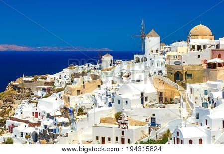 Breathtaking scenery of Oia village traditional Greek island architecture at Aegean sea background. Santorini island, Greece