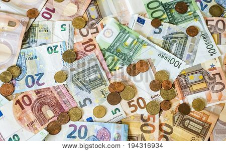 savings Cash money concept euro banknotes of all sizes and cent coins on desk
