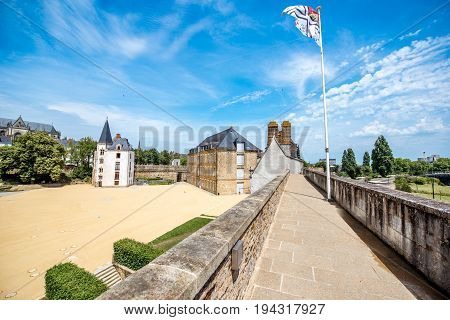 View on the castle of Dukes of Brittany during the sunny weather in Nantes city in France