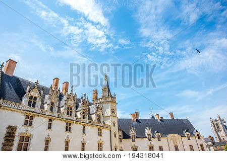 View on the castle of Dukes of Brittany with blue sky during the sunny weather in Nantes city in France