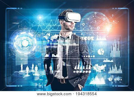 Front view of a bearded man wearing a suit and VR glasses and standing in a futuristic environment. HUD and graphs behind him. Toned image double exposure.