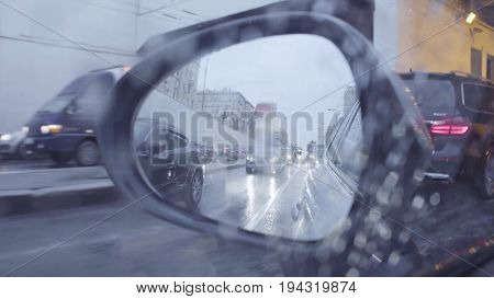 Point of view in car's rearview mirror on the city street. Moscow, may, POV