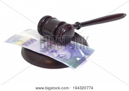 Judge Gavel And Swiss Thousand Franc Currency Isolated