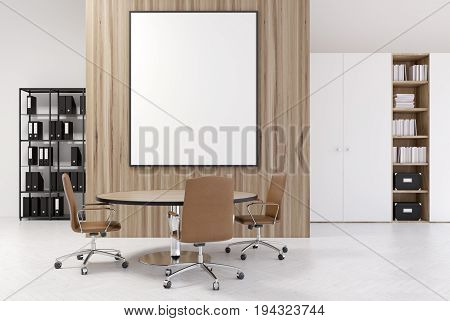 White and wooden office interior with a bookcase a closet a round table with brown chairs and a vertical framed poster on a wall. 3d rendering mock up