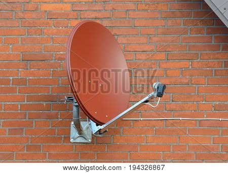 image of satellite dish on a brick wall