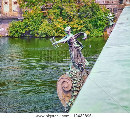 Prague, Czech Republic. Statue of a woman with torches on the Cechuv Bridge in Prague