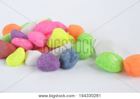 Color stones on the white abstract background.