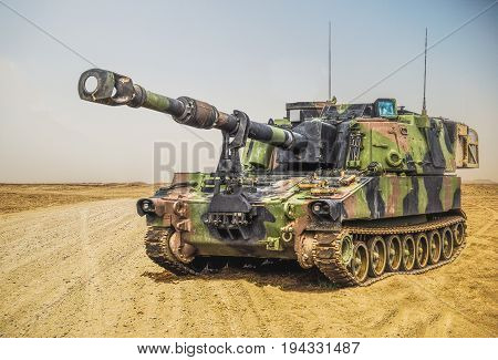 an american howitzer stands on a battlefield