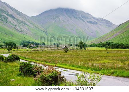 Stunning rural green landscapes in Wasdale, Lake District National Park, England, mountains on the background, selective focus