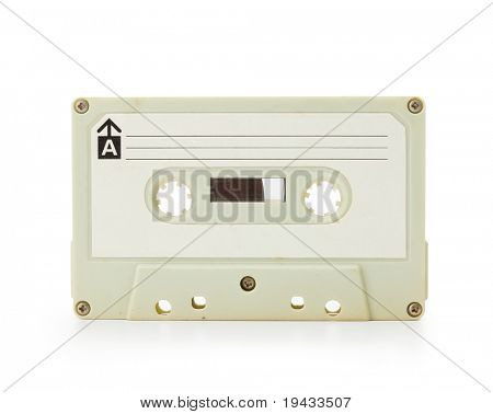 Early 70's cassette tape isolated on white with slight reflection.