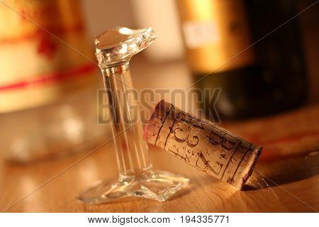 Broken up wine glasses with cork stopper