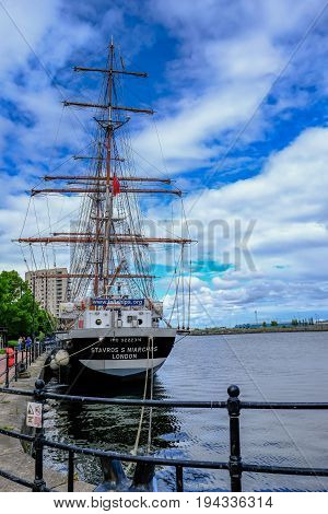 Cardiff Bay Wales - May 21 2017: Stavros S Niarchos Tall Ship Training ship moored near the barrage at Cardiff Bay on a bright early summer's day.