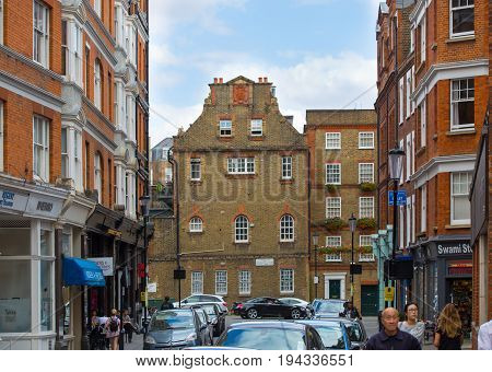 London, UK - September 8, 2016: Residential aria of Kensington with row of periodic buildings. Luxury property in the centre of London.  Kensington church street.