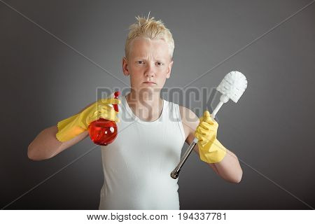 Child Holding Toilet Scrubber And Spray Bottle