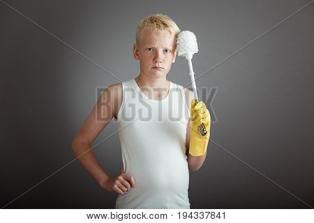 Pouting Boy Holding Toilet Scrubber