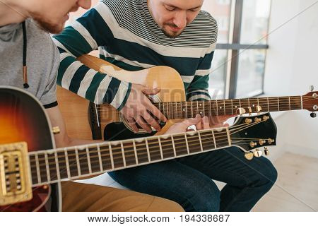 Learning to play the guitar. Music education and extracurricular lessons. Guitarist