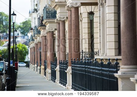 London, UK - September 8, 2016: Entrances with columns to the residential apartments in Kensington. Luxury properties of London