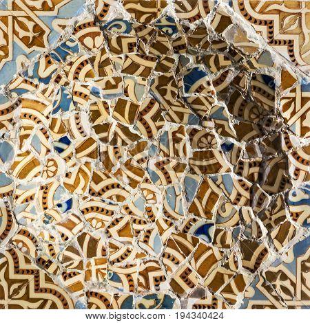 Barcelona, Spain - July 7, 2017: Glass mosaic broken ceramic tile decoration in Park Guell, Barcelona, Spain.
