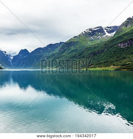 Norway, mountain lake Oldenvatnet with the glacier Briksdal