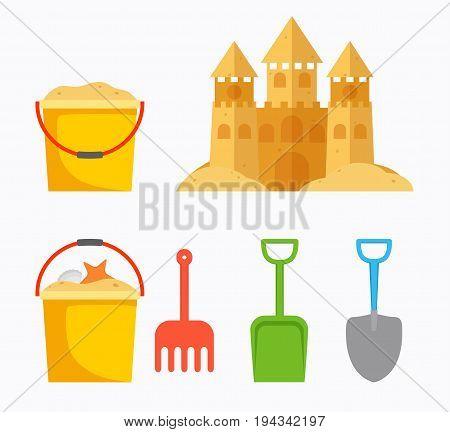 Beach sand castle with children's bucket sand bucket shovel rake. Baby summer accessories for beach.