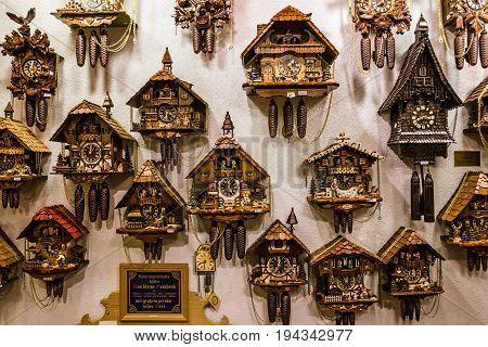Munich, Germany - July 5, 2017: Vintage cuckoo clocks in shop of Bavaria, Munich, Germany