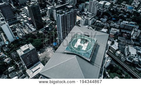 Aerial drone top view of helipad isolated on top of the skycraper in Bangkok city