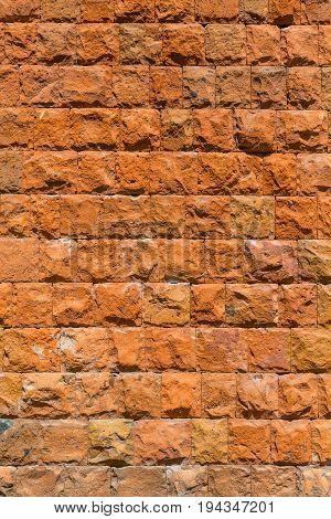 A wall of red stone. Textured background.
