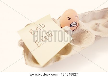 One bad egg with a face drawn on it