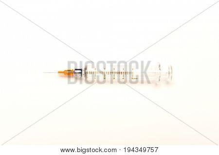 Medical syringe isolated over white background