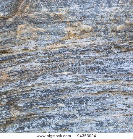 Rough texture of raw natural torn stone. Square stock photo ready design for decorative tile.