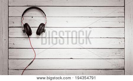 Music concept, Headphones on wooden desk table
