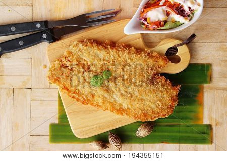 Fried dory fish with vegetable salad delicious