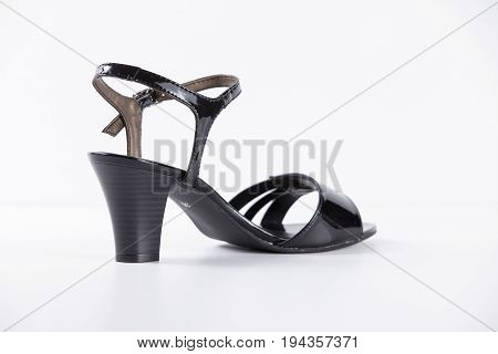Female Black Sandal on White Background, Isolated Product, Top View, studio.