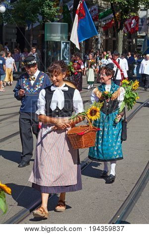 ZURICH - AUGUST 1: Swiss National Day parade on August 1, 2016 in Zurich, Switzerland. People in historical costumes marching on the Bahnhofstrasse in Zurich