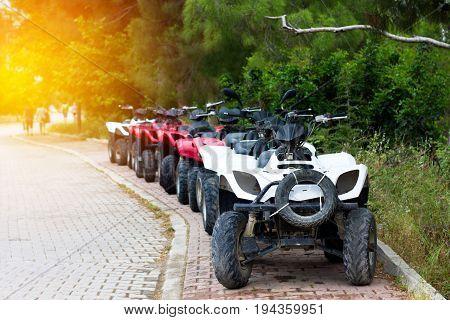 Some Quad Bikes Standing Near Road