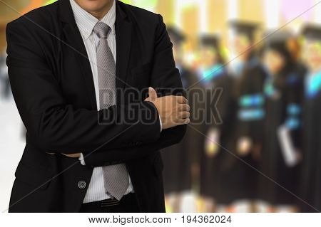 Young businessman standing on the back of Peoples Graduation degree background