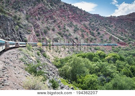 CLARKDALE, AZ - JULY 2.  Passengers aboard the Verde Canyon Railroad enjoy a scenic ride through Verde Canyon on July 2, 2017 at Clarkdale, AZ.