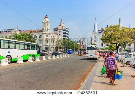 YANGON, MYANMAR - FEBRUARY 22, 2016: Facade of AYA Bank building at blue sky in Yangon Myanmar. AYA Bank is a private bank in Myanmar.