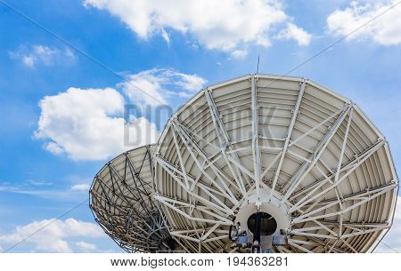 picture of parabolic satellite dish space technology receivers under blue sky