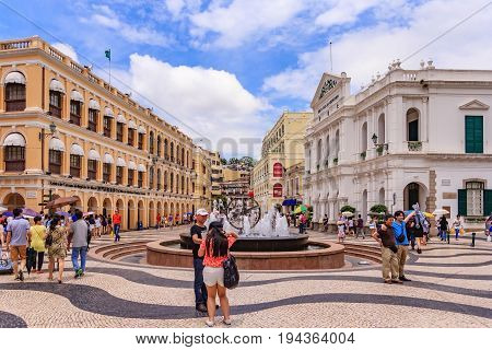 MACAU, CHINA - JULY 22, 2013: Historic Centre of Macau-Senado Square in Macau China. The Historic Centre of Macau was inscribed on the UNESCO World Heritage List in 2005.