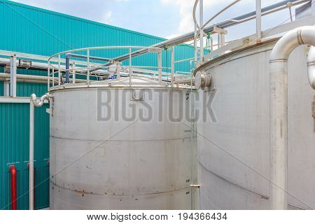 Outdoor steel bulk storage tanks in blue sky background for industrial and factory