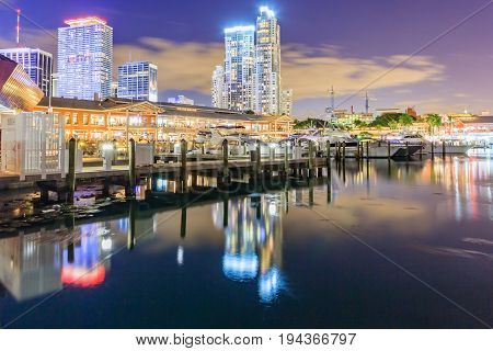 MIAMI, FLORIDA, USA - DEC 31, 2016 : Bayside Marketplace at dusk in Miami Florida. It is a festival marketplace and the top entertainment complex in Downtown Miami attracting 15M people annually.