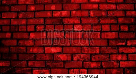 Red brickwork. Red brick. Red wall.  Red grunge. Brick, brick wall texture, brick wall background.  Brick wall. Red. Grunge, grunge background.Colored brick.