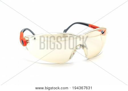 Plastic safety goggles on a white background with clipping path Safety equipment