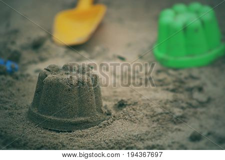 Children's beach toys. Sand cake in the sandbox