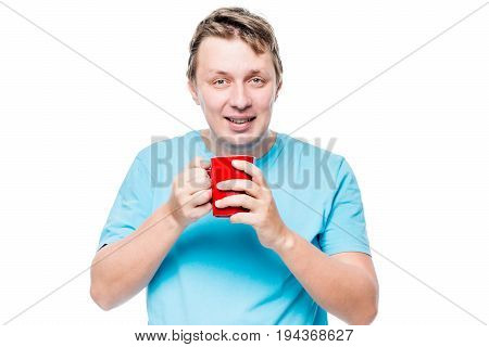 Portrait Of A Man With A Cup Of Coffee In The Morning After Awakening On A White Background