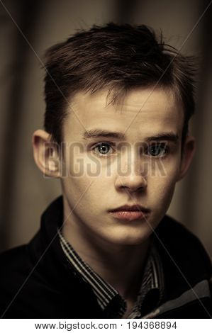 Sepia Tone Image Of Solitary Boy Staring