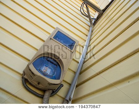 Voronezh, Russia - May 04, 2017: Electric counter in the protective box on the wall of the house
